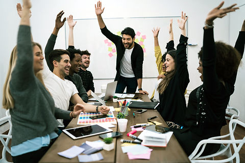 happy-business-team-celebrating-with-raised-up-hands-in-the-office-success-and-winning-con