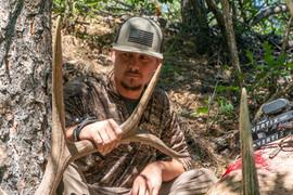 Brandon Adams admiring downed elk