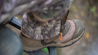 Brandon Adams boot in tree