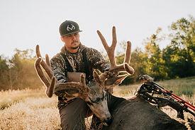 Brandon Adams with Colorado mule deer