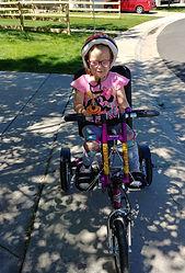 Chloe with her Bike_edited.jpg