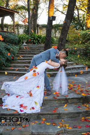 Bride and Groom kissing on ceremony site in The Gardens