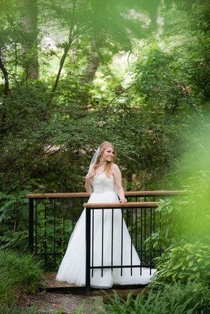 Bridal pictures on a bridge in The Gardens