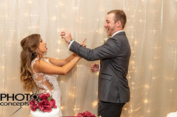 Bride and groom, indoor facility, banquet hall,eating cake