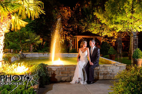 Couple sitting by Entrance Fountain in The Gardens