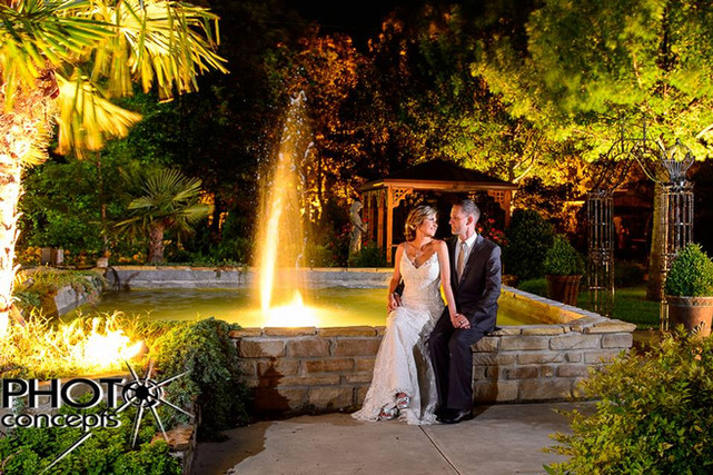 bride and groom by the fountain