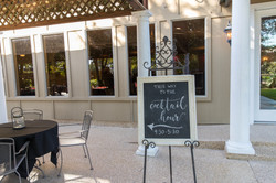 sign for Pre-cocktail hour, on the outdoor patio, outdoor receptionout