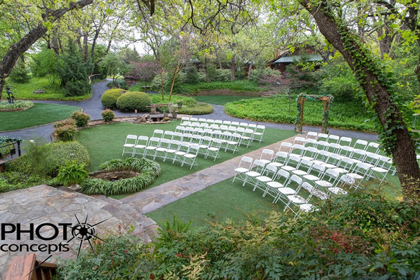 Outdoor wedding chair set up in The Gardens