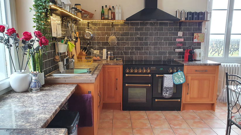 Spacious kitchen with double oven and everything you need.