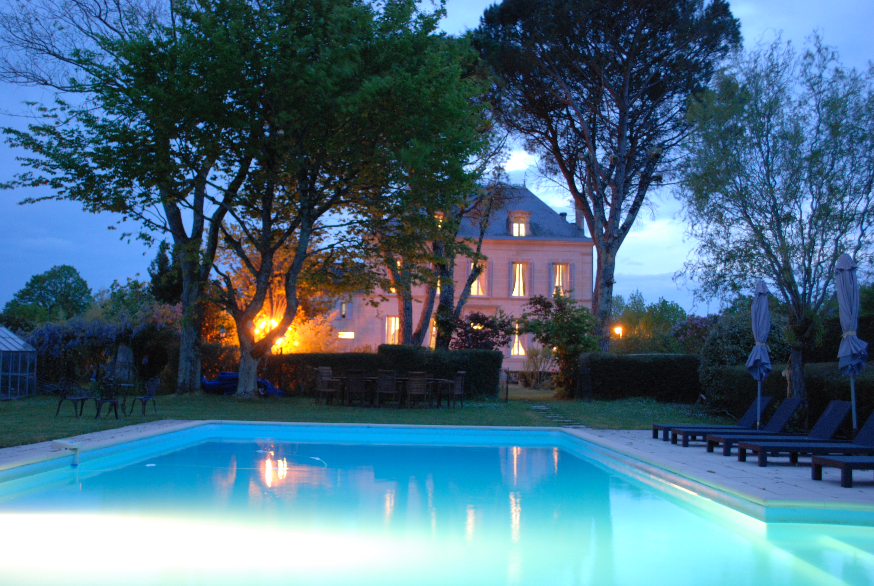 Pool, garden and house in the evening