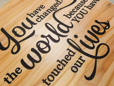 Wood sign lettering that we designed and installed for a farewell gift.