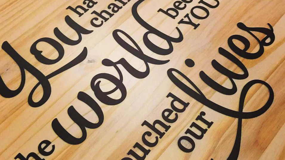 Typography design that we designed and applied to wood for a going away gift.