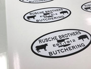 Rusche Brothers decals that we created for their butcher shop.