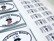 Tri-County Beard decals and beard oil product labels.