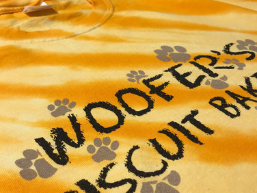 Employee shirts that we printed for Woofers Biscuit Bakery in Anderson.