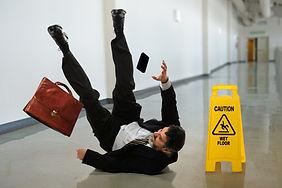 Senior businessman falling near caution