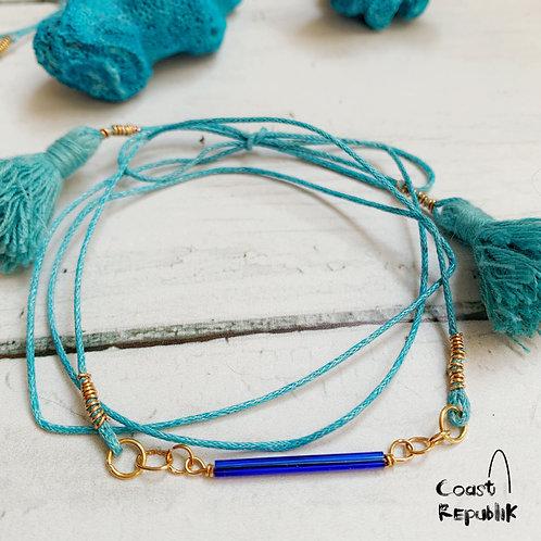 Lien pompoms bleu marine