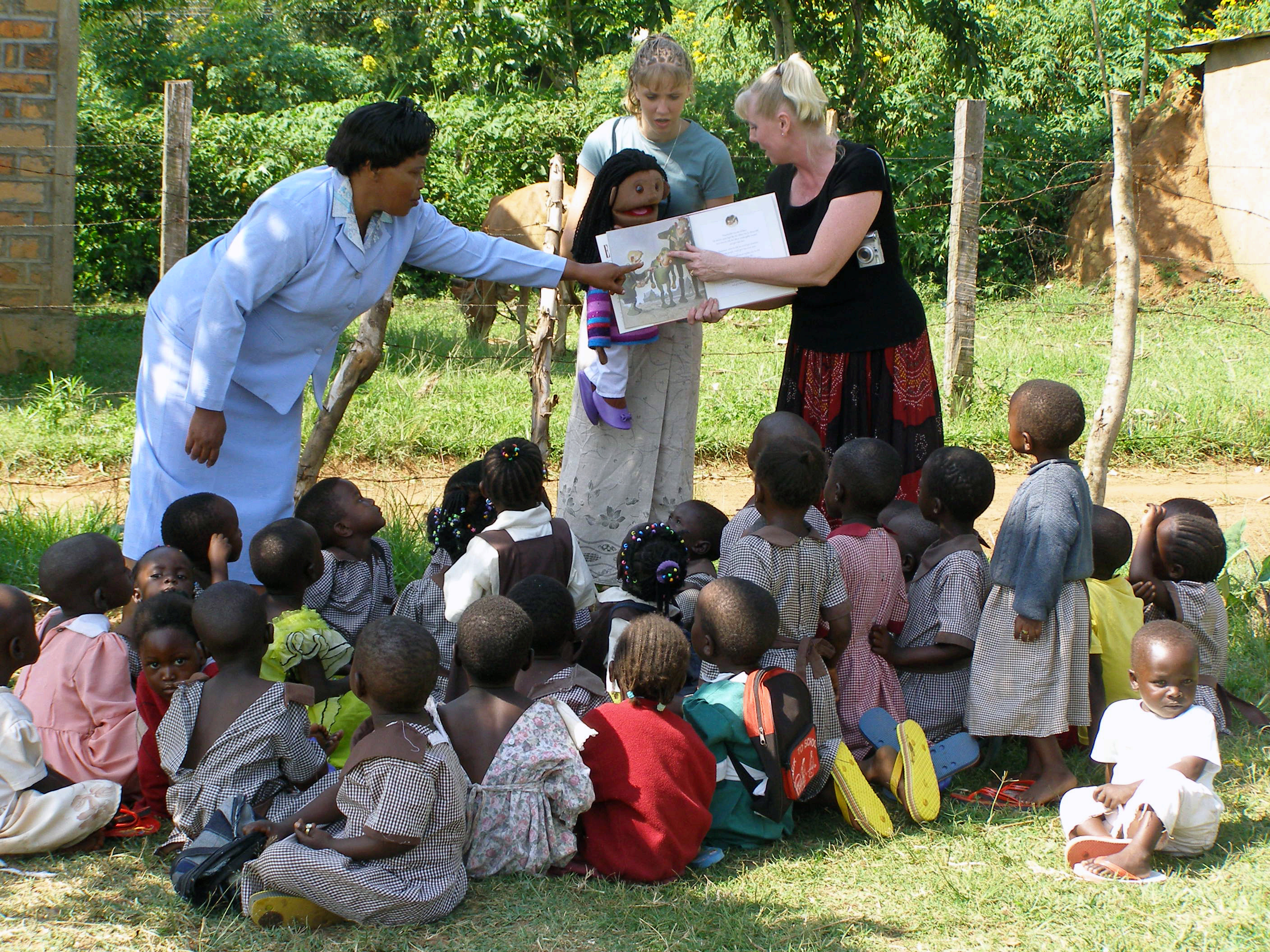 Tina teaching orphans