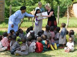 Tina teaching orphans
