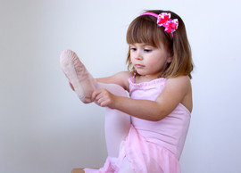 Little ballerina dancer putting on her s
