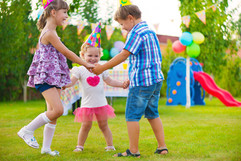 Three little kids celebrating birthday d