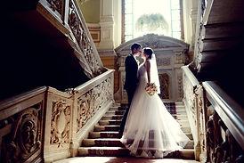 Wedding couple indoors is hugging each o