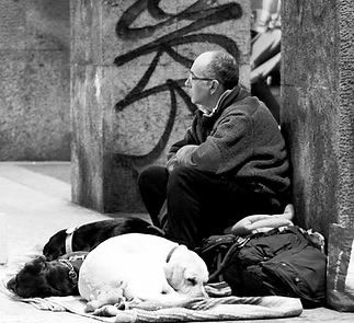 homeless man in London with his dog
