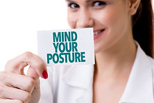 "Picture of woman holding a sign stating, ""Mind you  posture"" for Awoolfsson Osteopaths Harrow"