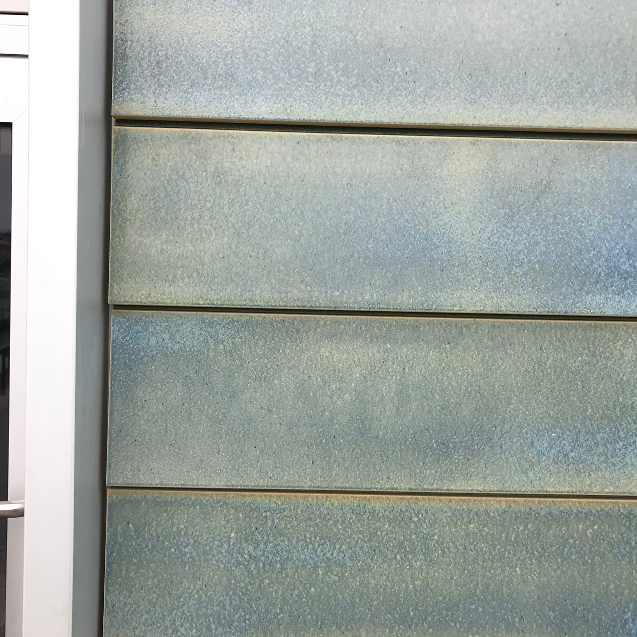 Ceramic tile cladding in blue and green (reflecting the colours of the sea at Porthmeor beach) on the recently opened extension to the Tate St Ives.