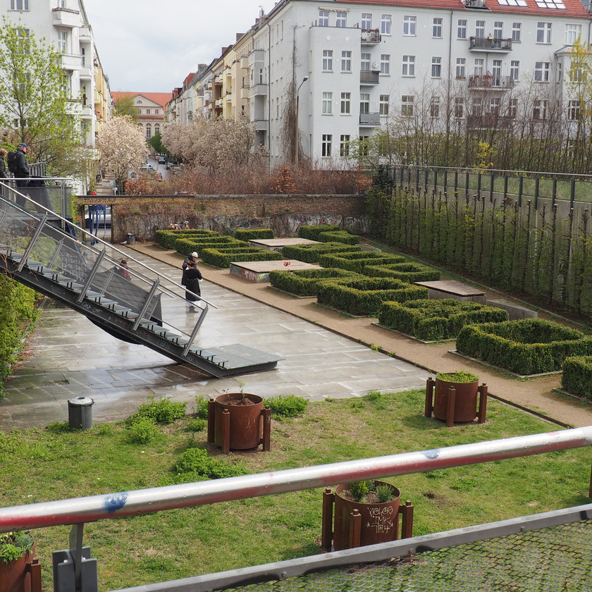 A sunken garden at the Mauerpark reinterpreting a derelict building footprint and industrial artefacts into a postmodern baroque