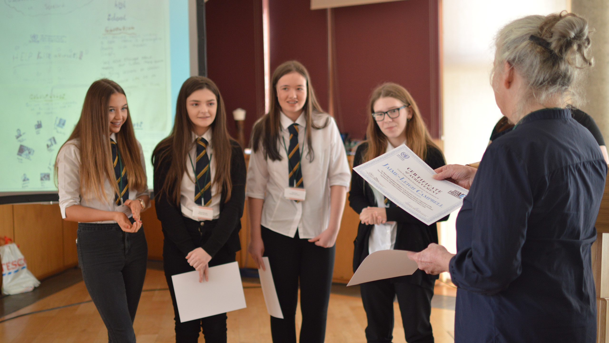 Winners of the Scottish Schools Competition, Kircaldy High School, receive their certificates of achievement.