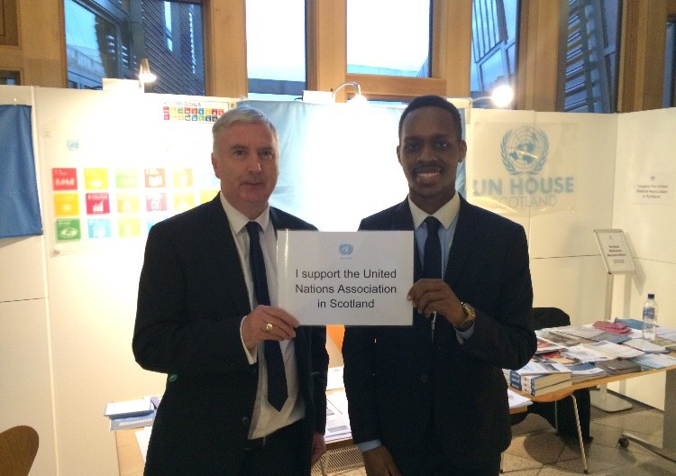 UNHS Intern Matthew Mungai with MSP James Kelly