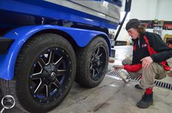 Boat trailer wheel cleaning
