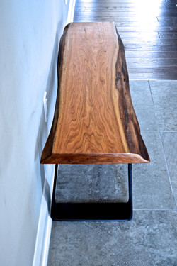 Live-edge butternut and steel bench