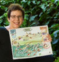 Image of Martha C. Bean holding a drawing she has done for a client to illustrate a strategic process