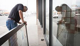 Service technician replacing door pivots