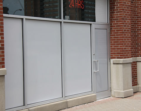 Aluminum store front with glass filled.