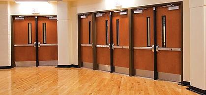 Door closure mounted in a school