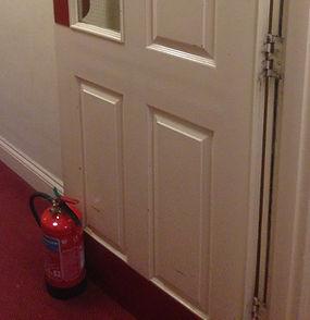 door held open fire code breach