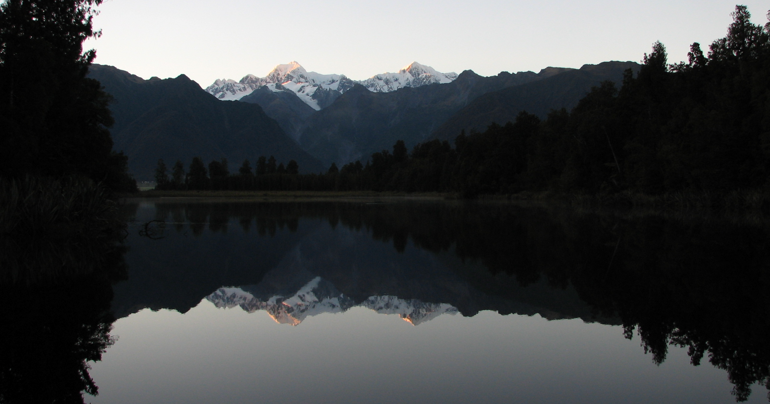 Mt Cook and Mt Tasman over Lake Matheson in Fox Glacier.JPG