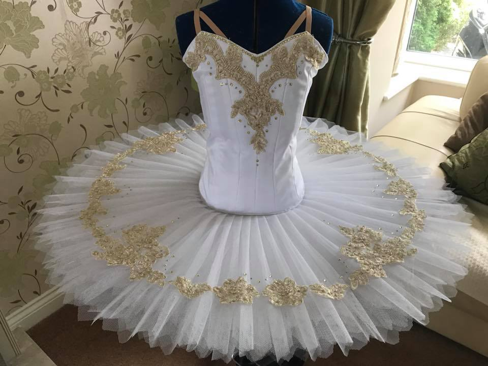 White and gold tutu