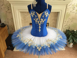 Blue with blue shaded skirt and gold emb