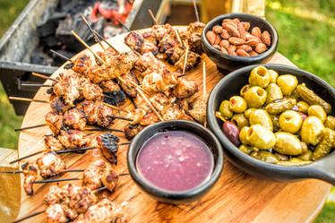 Almonds, olives, lamb skewers