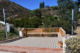 Trex composite deck with a bench and hammock posts