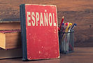 learn spanish concept. book on a wooden