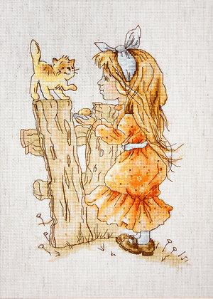 Little girl with a kitten