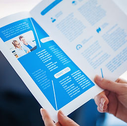Brochure design. Hands holding a print o