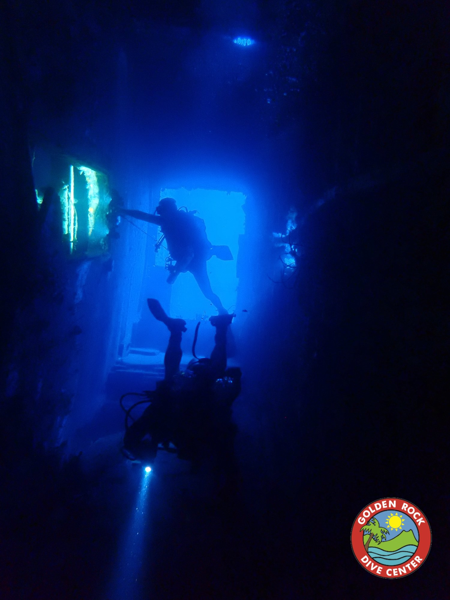 experienced scuba divers explore the wreck
