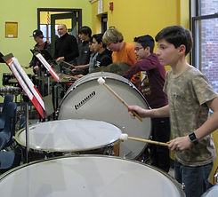 a line of boys playing drums