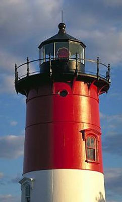 photo of a red and white lighthouse